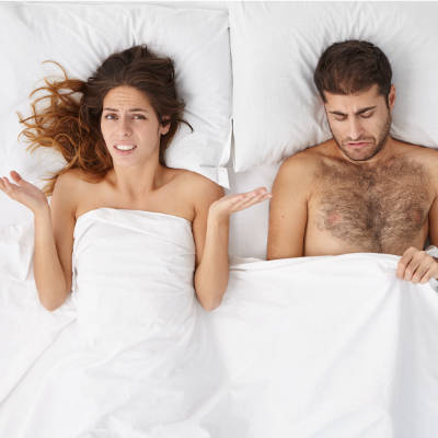 Woman with hands up from husband who suffers from impotence
