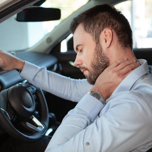 Guy Holding His Neck After A Auto Accident
