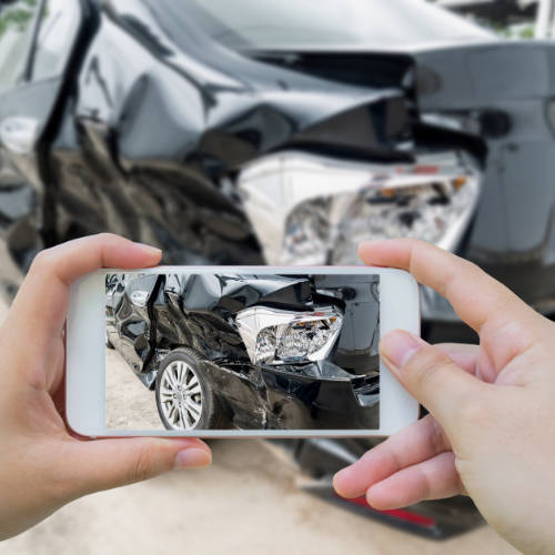 Taking pictures of damage following an auto accident